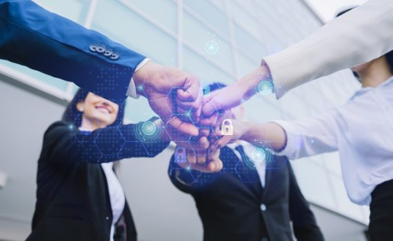 young-business-people-putting-their-hands-together_23-2148320003