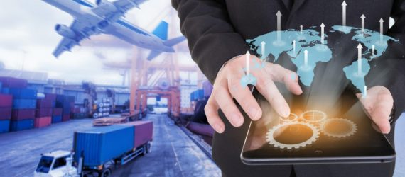 Image of businessman holding tablet ,Growing business concept on Global network coverage world map , Logistic Import Export background (Elements of this image furnished by NASA)
