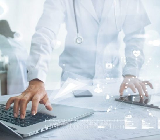 Doctor touching medical icon network connection on laptop and tablet with modern virtual screen interface, medical technology network concept